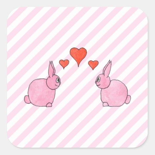 Conejos rosados con los corazones calcomania cuadradas personalizadas
