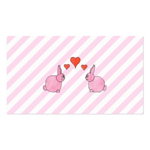 Conejos rosados con los corazones tarjetas de visita