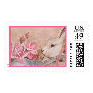 Conejos y rosas sello postal