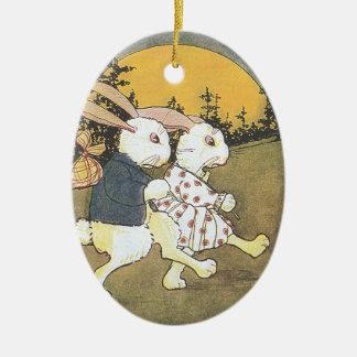 Conejos y sol naciente adorno navideño ovalado de cerámica