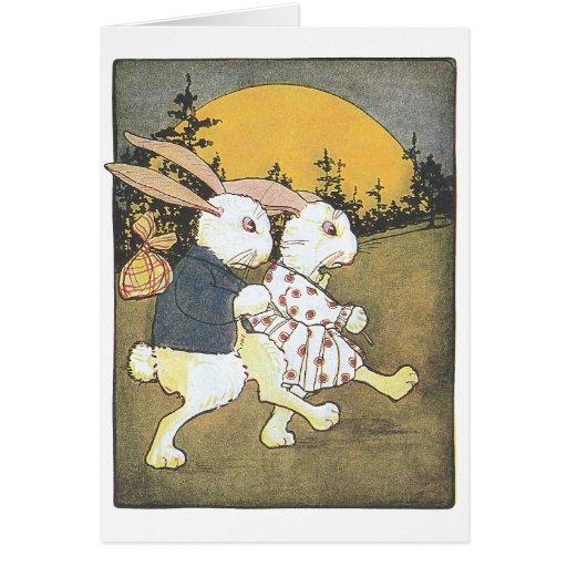 Conejos y sol naciente felicitación