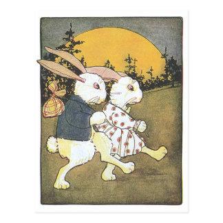 Conejos y sol naciente postal