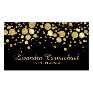 Confeti de la hoja de oro en tarjeta de visita