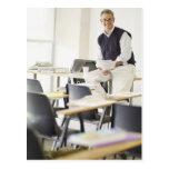 Confident professor leaning on desk in classroom postcard