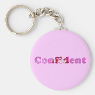 Confident spelled with pink flowers Key Chains