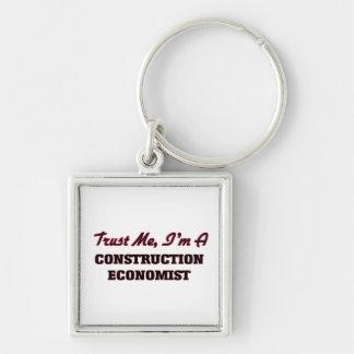 Confíe en que yo es economista de la construcción llaveros personalizados