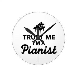 Confíe en que yo es pianista relojes de pared