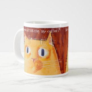 Confrontational orange cat with round eyes large coffee mug