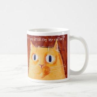 Confrontational orange cat with round eyes classic white coffee mug