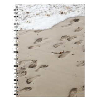 Confused Footsteps in the sand Notebook