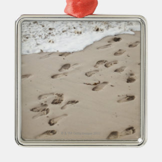 Confused Footsteps in the sand Christmas Tree Ornaments