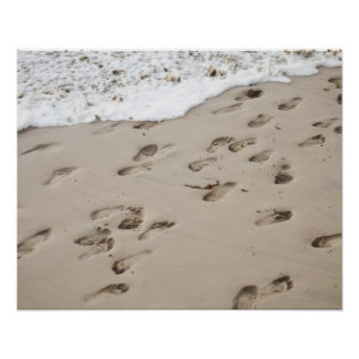 Confused Footsteps in the sand Poster