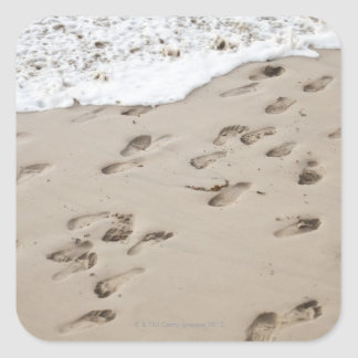 Confused Footsteps in the sand Square Sticker