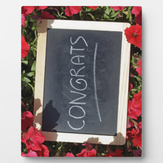 Congrats text written and save flowers plaque
