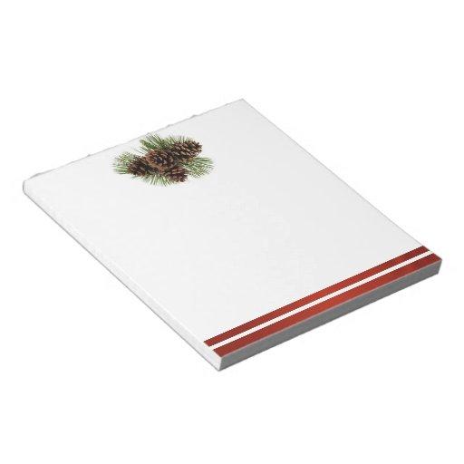 Conos del pino y satén rojo bloc de papel
