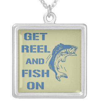Consiga el carrete y los pescados encendido joyerias