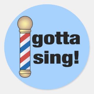 Consiguió cantar el regalo de la barbería etiqueta redonda