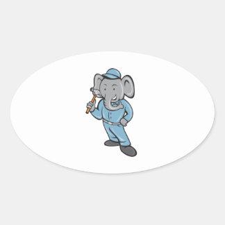 Constructor del elefante que lleva a cabo el pegatina ovalada