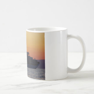 Container ship at sunset coffee mug
