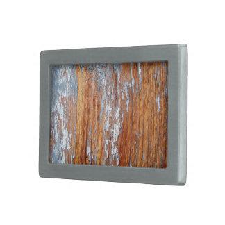 Contexto de madera rugoso hebillas cinturon rectangulares