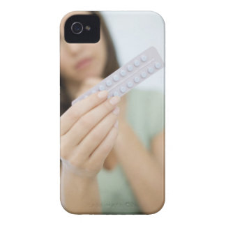 Contraceptive pills in a woman's hand. iPhone 4 case