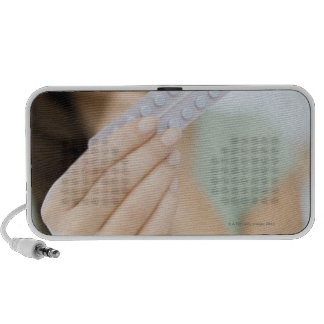 Contraceptive pills in a woman's hand. travelling speakers