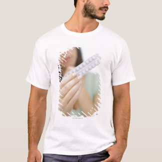 Contraceptive pills in a woman's hand. T-Shirt