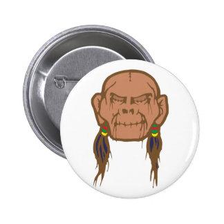Contraction head shrunken head pinback button