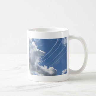 Contrails of aircraft and clouds in the sky coffee mug