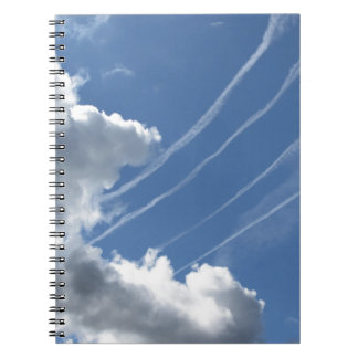 Contrails of aircraft and clouds in the sky notebook