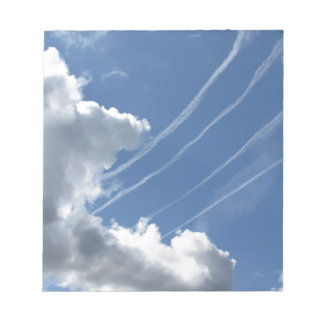 Contrails of aircraft and clouds in the sky notepad