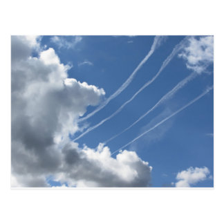 Contrails of aircraft and clouds in the sky postcard