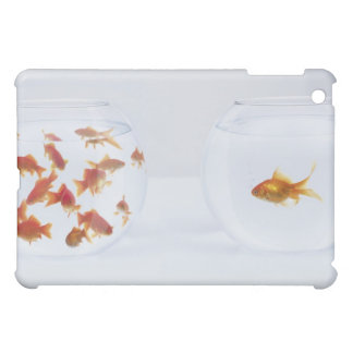 Contrast of many goldfish in fishbowl and iPad mini cover