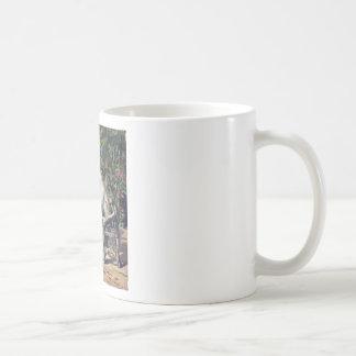 Conversación del gato taza de café