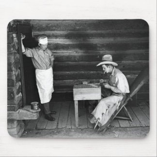 Cook watching a cowboy play cards mouse pad