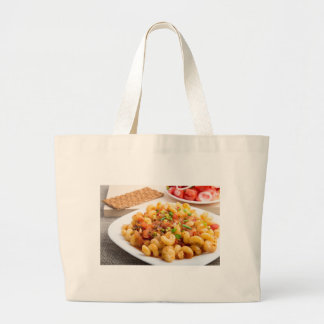 Cooked pasta cavatappi closeup large tote bag