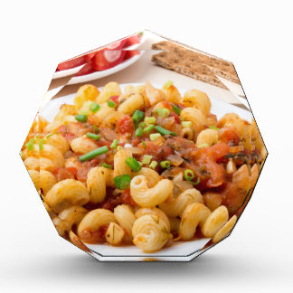 Cooked pasta cavatappi with stewed vegetable sauce award