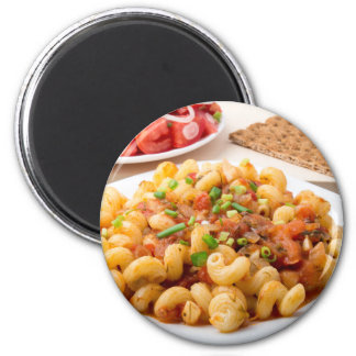 Cooked pasta cavatappi with stewed vegetable sauce magnet