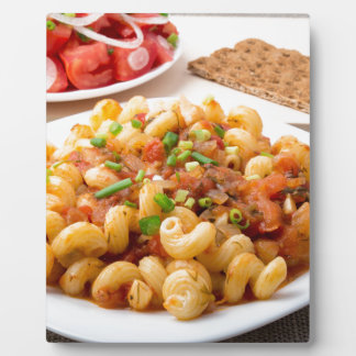Cooked pasta cavatappi with stewed vegetable sauce plaque