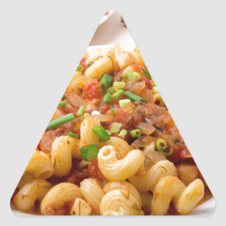 Cooked pasta cavatappi with stewed vegetable sauce triangle sticker