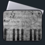 "Cool antique grunge effect piano music notes laptop sleeve<br><div class=""desc"">Cool antique grunge effect piano music notes and swirls faded black white and grey image</div>"