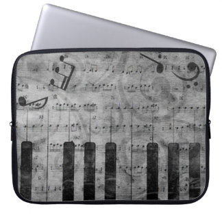 Cool antique grunge effect piano music notes computer sleeves