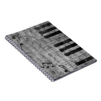 Cool antique grunge effect piano music notes spiral note book