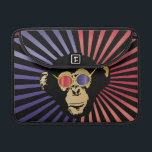 """Cool Chimpanzee In 3D Glasses Sleeve For MacBooks<br><div class=""""desc"""">A funny and hip chimpanzee,  looking very cool wearing 3D glasses on a colorful retro red,  blue and black starburst pattern background.</div>"""