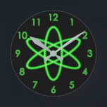 """Cool Fun Unique Neon Light Green Atomic Symbol Round Clock<br><div class=""""desc"""">This cool design features a glowing neon green atomic symbol and numbers. A unique clock,  and great for any science lover.</div>"""