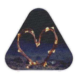 Cool heart shape made from lighting on beach sand bluetooth speaker