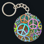"Cool Peace Love Heart Keychain<br><div class=""desc"">Cool retro vintage style peace heart art by Island Vintage.  Artistic groovy peace signs form a colorful heart shape. Funky peace sign art for cool people,  hippies,  peaceniks,  world peace,  peace on earth,  anti war activists and just plain cool folks of all ages. Peace love and awesomeness... </div>"