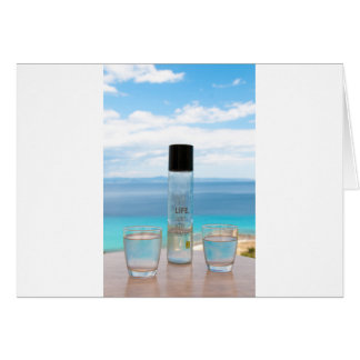 Cool water filled bottle and glasses greeting card