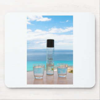 Cool water filled bottle and glasses mouse pad