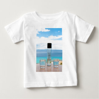 Cool water filled bottle and glasses t-shirt